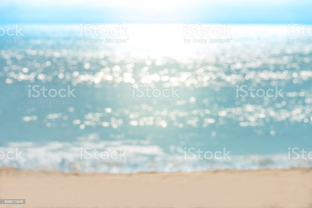 Sea water bokeh and sand beach stock photo
