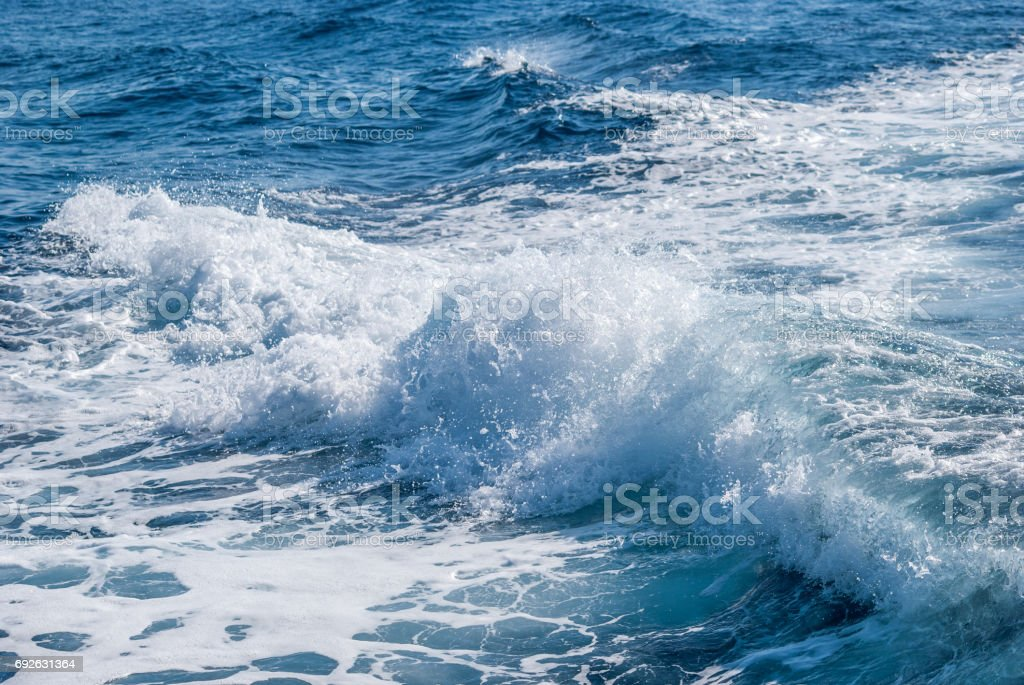 Sea water seen from a ship stock photo