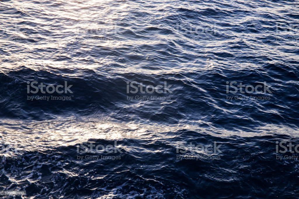 Sea water texture in sunrise light. Water background texture. Sea...