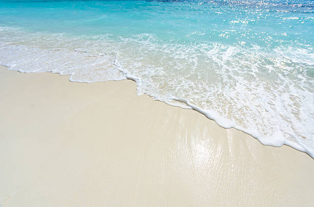 Sea wave and beach sand background stock photo