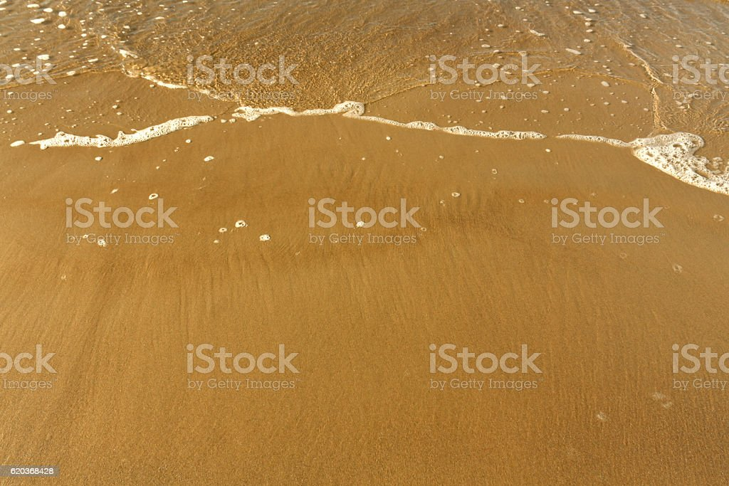 Sea wave and sandy shore. zbiór zdjęć royalty-free