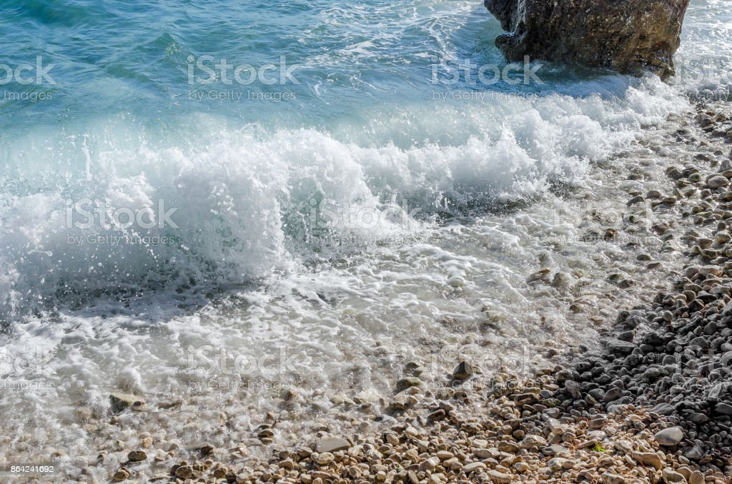 Sea wave is broken about stones. royalty-free stock photo