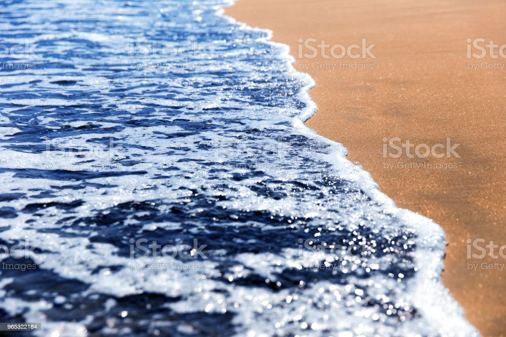 Sea wave on the sand royalty-free stock photo