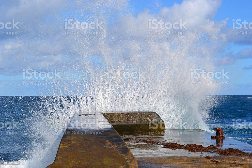 Sea wave shattered the pier royalty-free stock photo