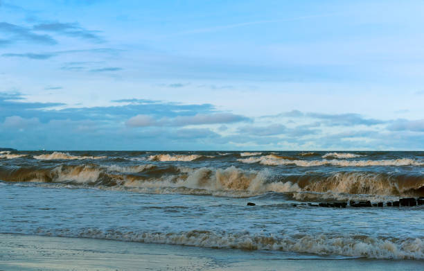 sea wave, storm at sea, waves lapping on the shore - swashbuckler stock photos and pictures