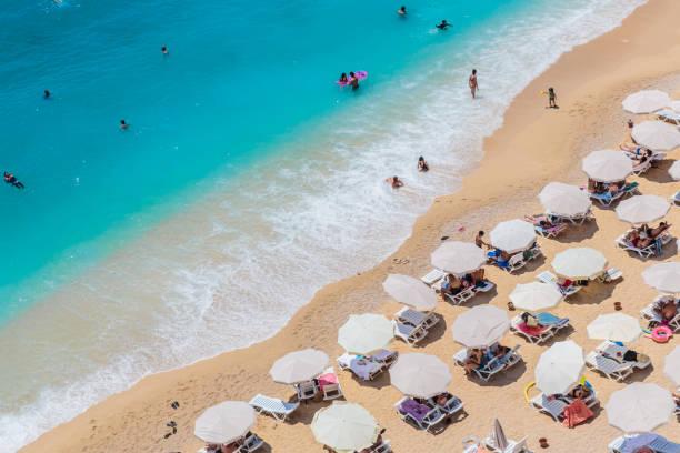 Sea waves and beach with sun umbrellas, aeral view, Kaputash beach stock photo