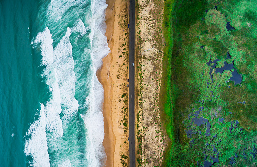 istock Sea waves, beach and road 815056538