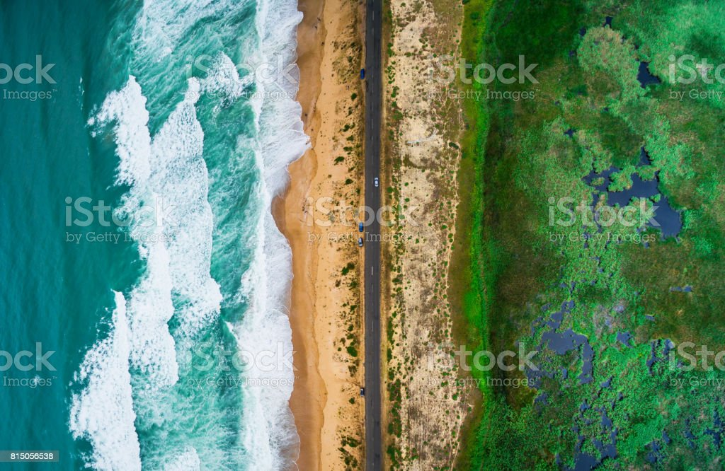 Sea waves, beach and road stock photo