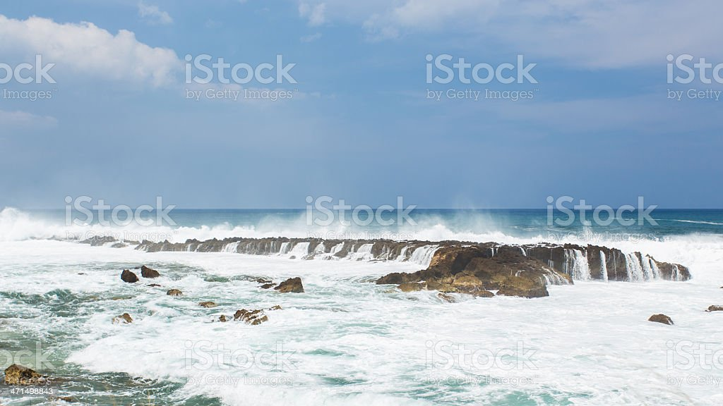 Sea waves hit the rock royalty-free stock photo