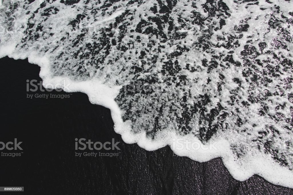 Sea waves on black sand beach stock photo