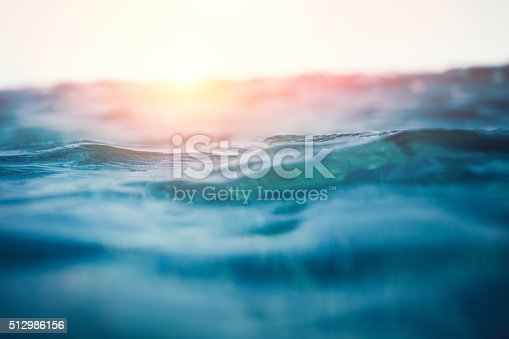 Sea waves at sunset. View from the water.