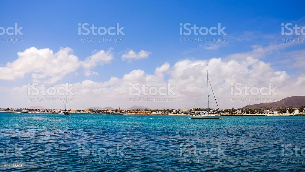 Sea with boats in Corralejo, Fuerteventura, Spain. stock photo