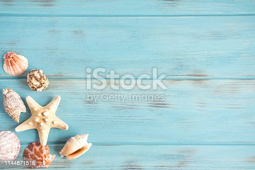 istock Sea wooden background of blue color with seashells. Natural seashells with copy space. The basis for the design of the marine banner, greeting card. Postcard from travel 1144871516