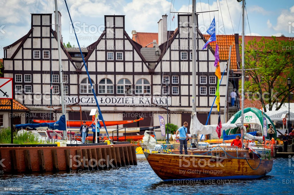 Sea yacht with tourists on the Motlawa river in Old Town in Gdansk, Poland stock photo