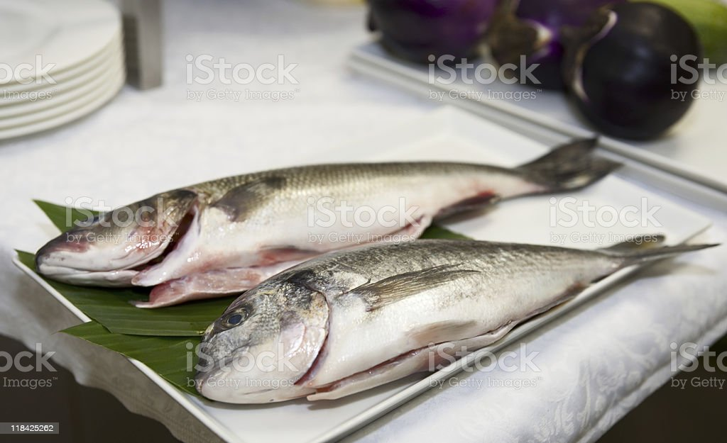 Seabass and gilthead bream prepared for cooking royalty-free stock photo