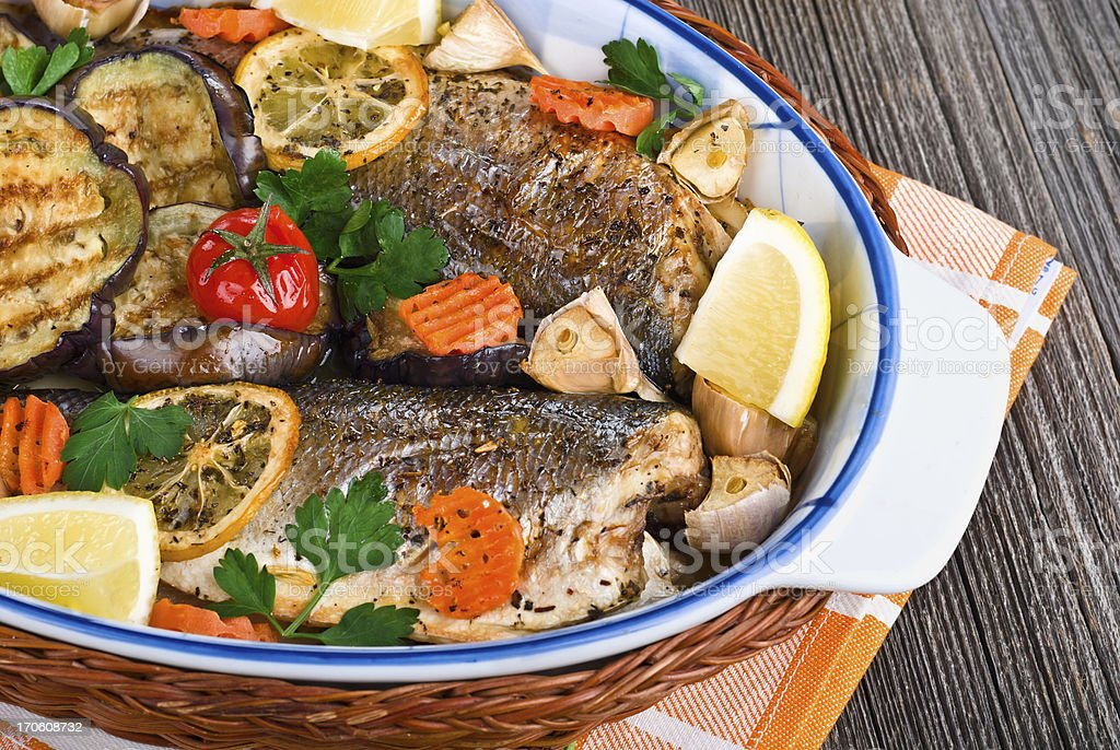 seabass fish baked with vegetables, close-up royalty-free stock photo