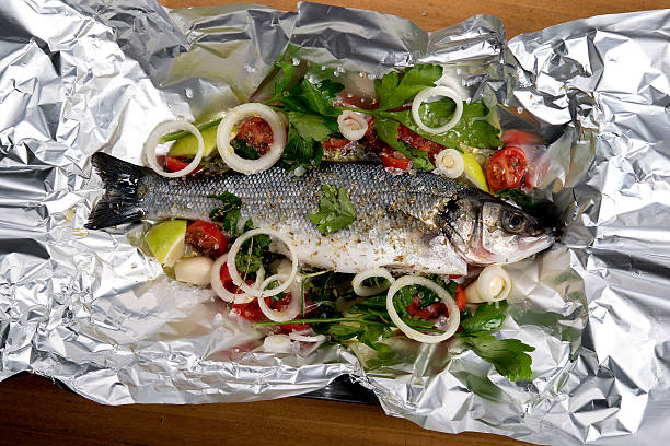 seabass in tin-foil ready to baked – Foto