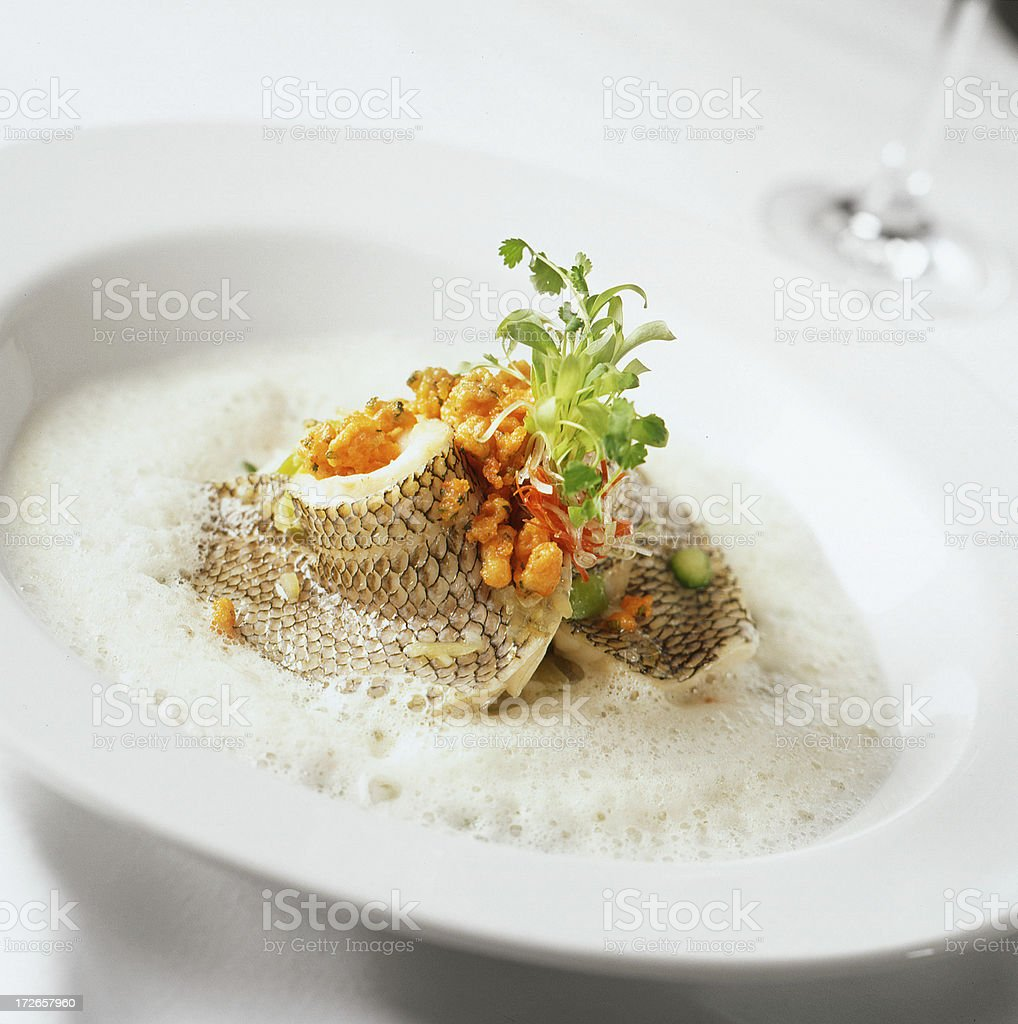 Seabass in White Sauce with Garnish royalty-free stock photo