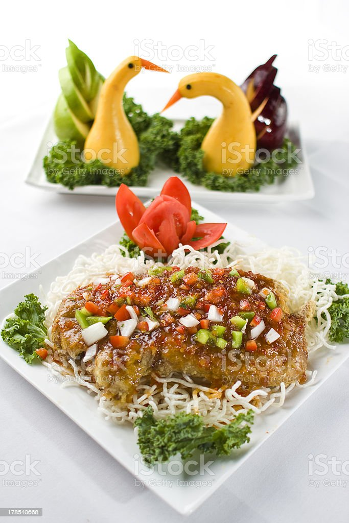 Seabass with Ginger Sauce and Crispy Noodles royalty-free stock photo