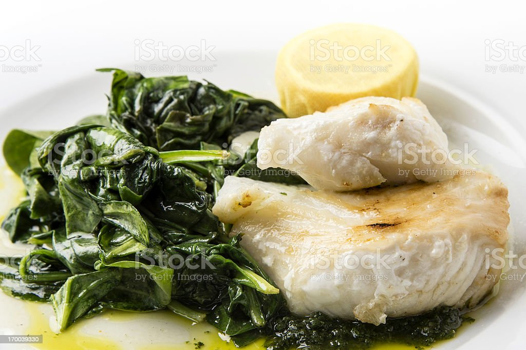 Sea-bass with spinach stock photo