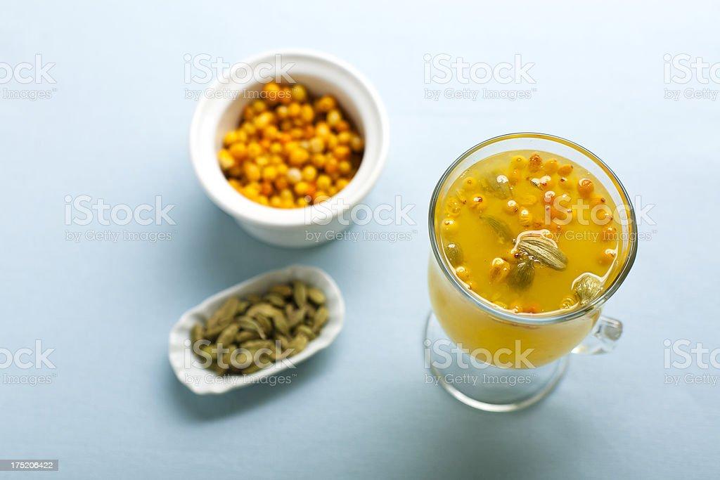 Sea-buckthorn and cardamom tea royalty-free stock photo