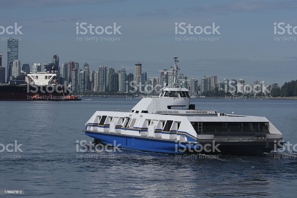 SeaBus Crosses Vancouver's Burrard Inlet on a Cloudy Summer Day stock photo
