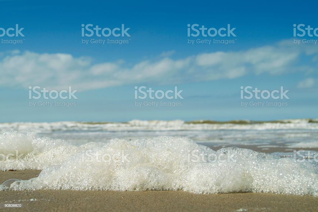 seafoam on the beach  afther a storm royalty-free stock photo