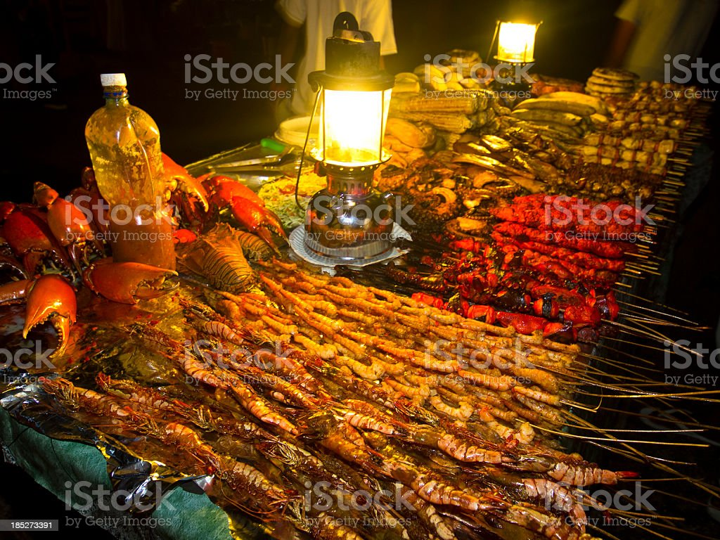 Seafood and vegetable stand at night stock photo