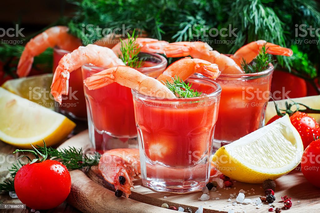 Seafood appetizer: shrimp with tomato sauce stock photo
