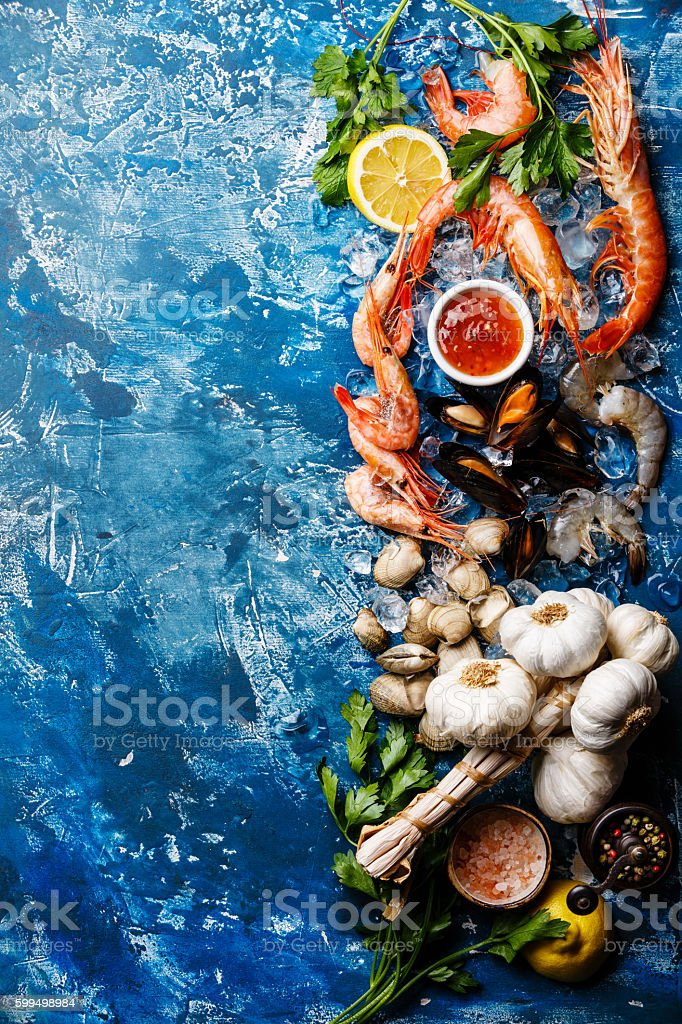 Seafood Background with raw Prawns and Clams stock photo