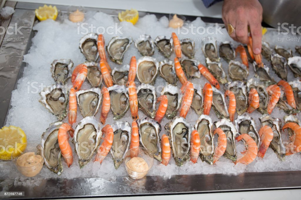Seafood buffet line Oyster and shrimps in hotel restaurant like a boat stock photo