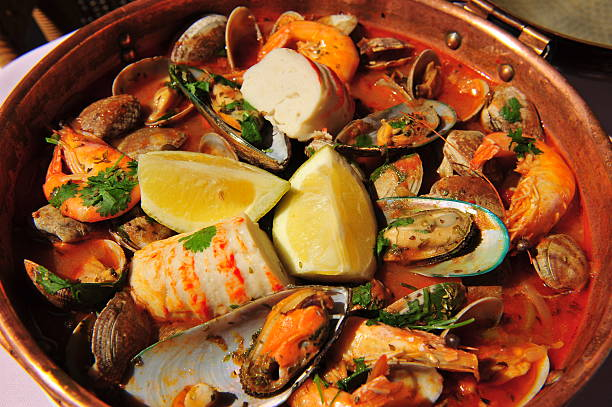 Seafood Cataplana - a Portuguese fish stew. stock photo