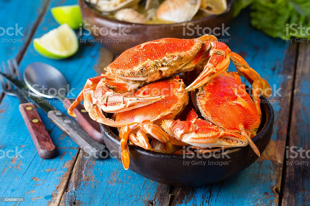 Seafood. Crabs in clay bowl and clams soup stock photo