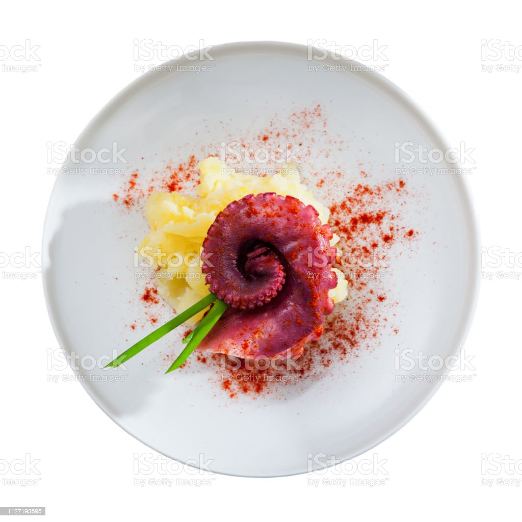 Seafood dish – boiled octopus with potato stock photo