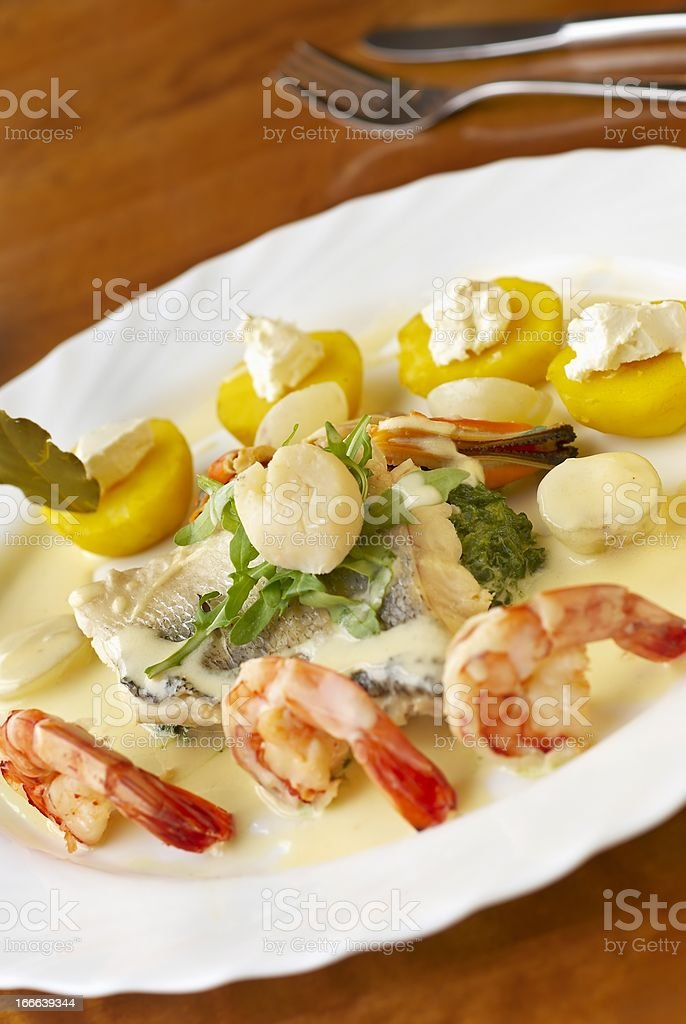 Seafood dish with spinach, potatoes and cream sauce royalty-free stock photo