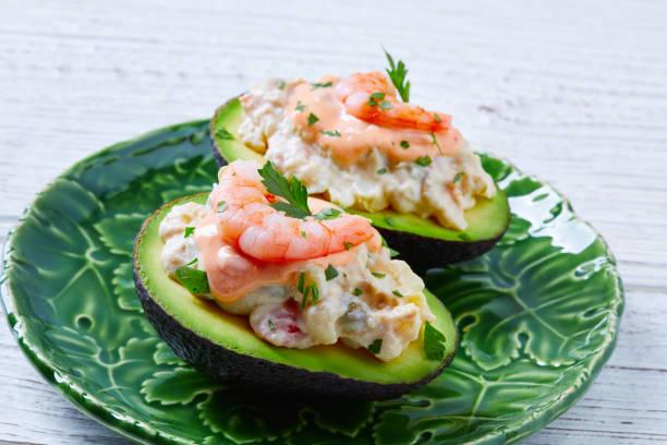 Seafood filled avocado with shrimps tapas pinchos stock photo