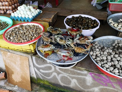 Crabs and shells on sale at a wet market in Pham Ngu Lao central tourist area in district 1 of Ho Chi Minh city, Vietnam.