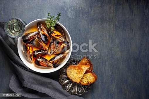 istock Seafood mussels with sauce and thyme with toasted bread 1254802741