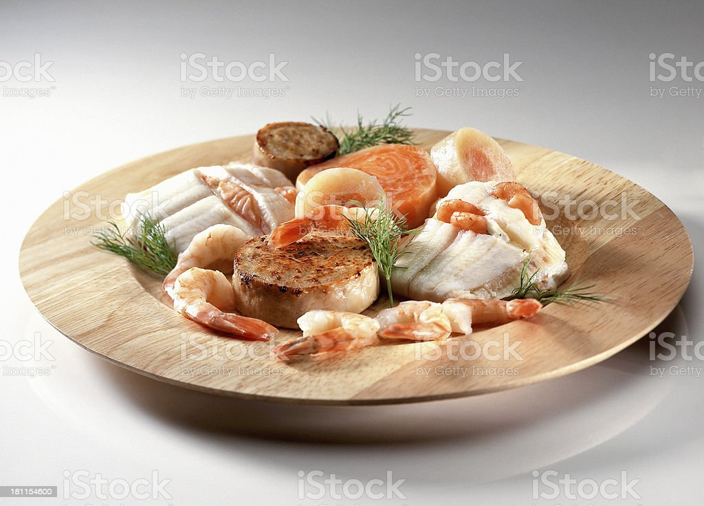 Seafood on wooden plate royalty-free stock photo