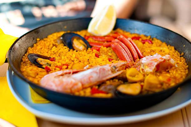 Seafood paella in black pan stock photo