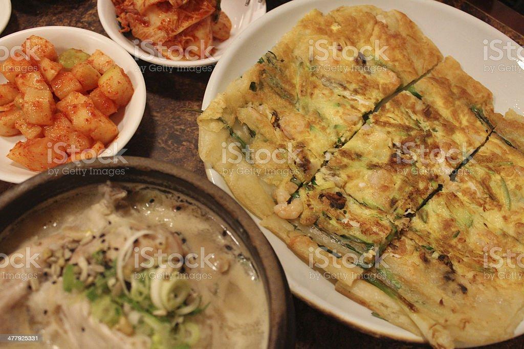 Seafood pancake and korean ginseng chicken soup royalty-free stock photo