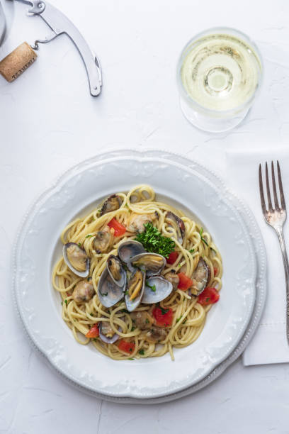 Seafood pasta with clams Spaghetti alle Vongole on white background stock photo