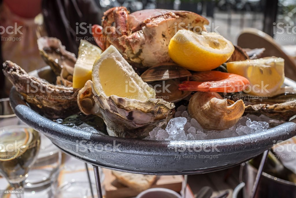 Seafood platter at sidewalk restaurant in Paris, France stock photo