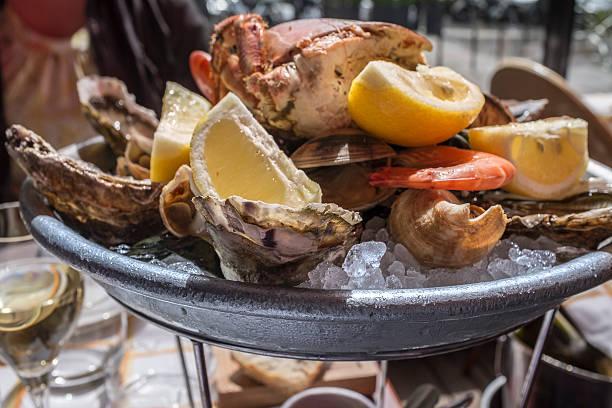 Seafood platter at sidewalk restaurant in Paris, France stock photo