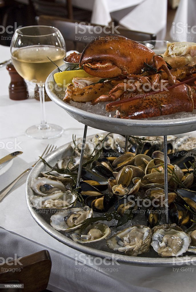 A seafood platter with oysters and crab claws stock photo