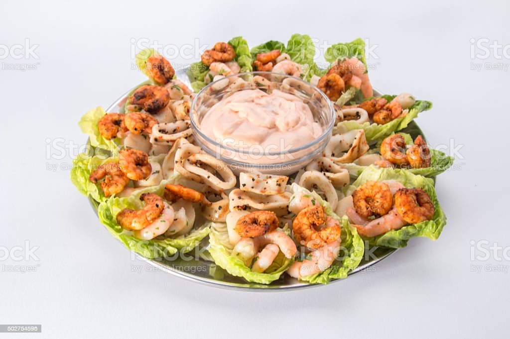 Seafood Platter with Prawns, calamari, scallops and seafood sauce stock photo