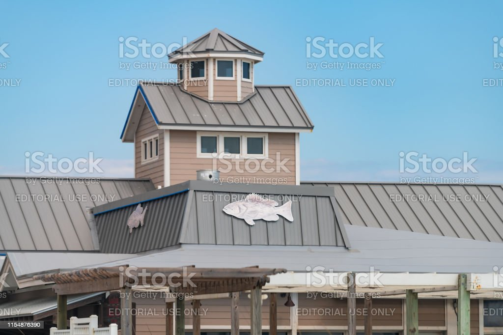 Seafood Restaurant Building Or Beach House With Fish On Roof