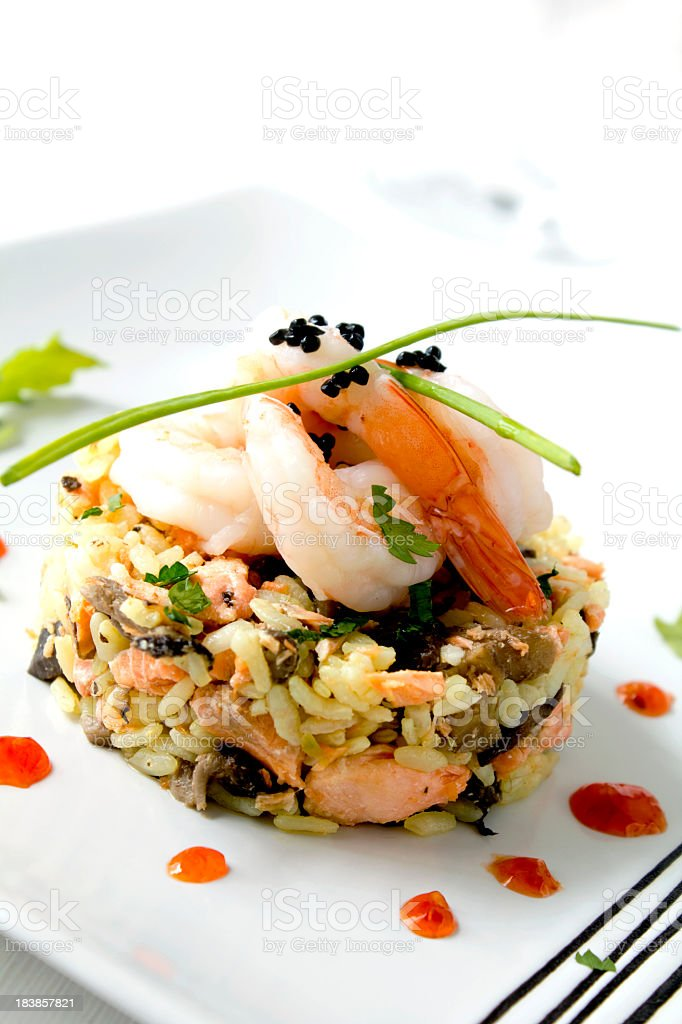 A seafood risotto on a white plate stock photo