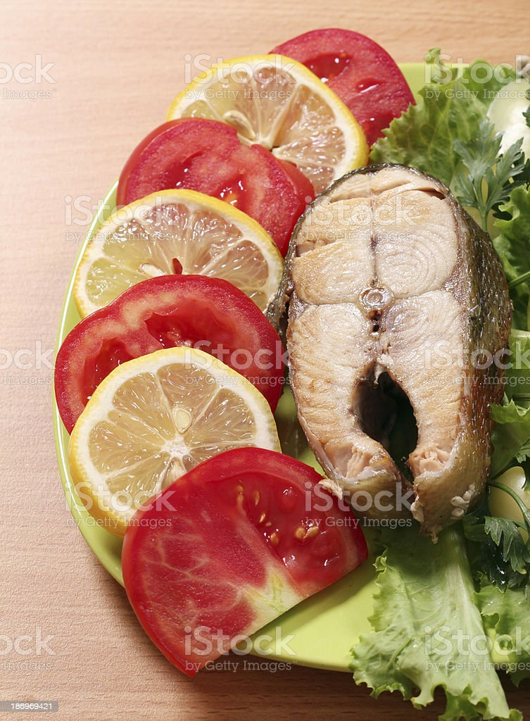 seafood salmon with lemon and tomatoes royalty-free stock photo