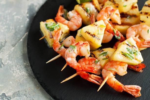 Seafood, shellfish. Prawns skewers stock photo
